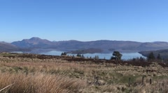 View of Loch Lomond and Ben Lomond shot from John Muir Way, Balloch. Sunny day. Stock Footage