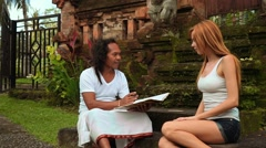 Balinese shaman tells fortune for caucasian woman Stock Footage