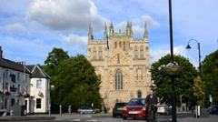 Timelapse traffic and pedestrians passing selby abbey, yorkshire, united kingdom Stock Footage
