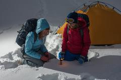Two backpackers asking a help Stock Photos