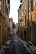Narrow street in old city centre Stock Photos
