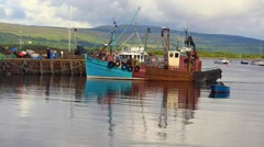 Fishing boat arriving at Tobermory, Isle of Mull, Scotland, UK Stock Footage