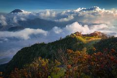 Sunset in a valley with active volcanoes. Java island, Indonesia Stock Photos