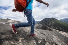 Hiker and volcano - stock photo