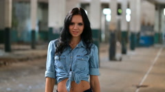 Beautiful brunette moves the camera, in a denim shirt - stock footage