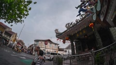 Chinese temple in Malaysian city of Penang at sunset. Pano down to up Stock Footage