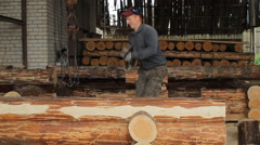 A man puts a beam with a hammer Stock Footage