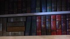 Antique books on bookshelf motion Stock Footage