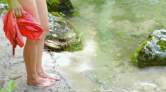 Woman Standing Next to the River Stock Footage