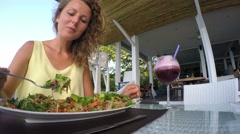 Attractive Woman Eating Salad at Cafe. Healthy Vegetarian Meal Stock Footage