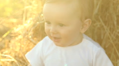 Kid in the white shirt in a field Stock Footage