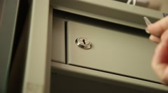 Key unlocked a safe latch and opening door safety deposit box Stock Footage