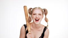 Young beautiful girl laughing, holding bat over white background. Slow motion Stock Footage