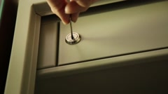 Key unlocked a safe latch and opening door safety deposit box. man folds Stock Footage