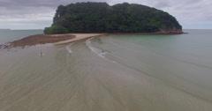 Aerial of people walking to clark island, whangamata beach, Coromandel Stock Footage