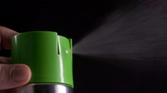 Closeup of spray can spraying aerosol insecticide or fragrance mist into the air Stock Footage