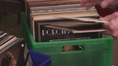 Sorting Through Boxes of Records in a Record Store Arkistovideo