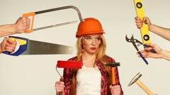 Cheerful girl builder and hands around her with building tools in them Stock Footage