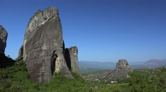 Meteora monolithic mount formations with the Kastraki village at the foot Stock Footage