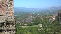 Meteora valley. Monastery of St.Nicholas Anapausas from the Monastery of Rousano Stock Footage