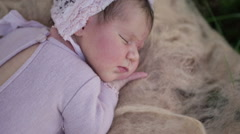 Sleeping newborn baby girl Stock Footage