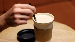 MIXING THE COFFEE ON THE TABLE IN NIGHT CAFE Stock Footage