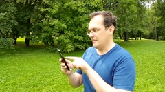 Man playing pokemon go on mobile phone. Stock Footage