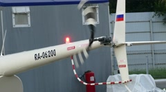 Closeup of the tail rotor of a helicopter at AEROSOJUZ heliport Stock Footage