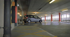 Multi-storey Car Park: tracking video of car entering empty parking facility Stock Footage