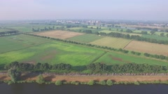 Aerial of vierdaagse  marches along canal in countryside,Middelaar,Netherlands Stock Footage