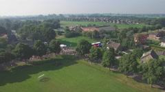 Aerial of vierdaagse  walkers passing a small village,Middelaar,Netherlands Stock Footage