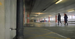 Multi-storey Car Park: Passengers exiting a parking facility Stock Footage
