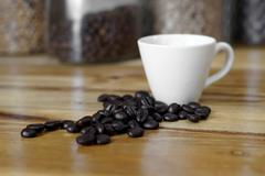 Cup of coffee with coffee beans Stock Photos