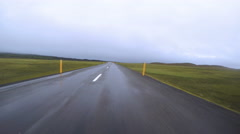 Driving pov into rainstorm high speed road time lapse Iceland 4k Stock Footage