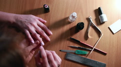 Manicure Process. Nail Polish Applying to Hand Stock Footage