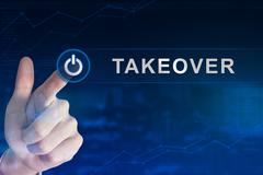 Business hand clicking takeover button Stock Photos
