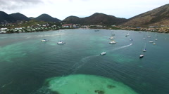 Al view of French Caribbean Island Saint Martin from pinel island.Sailboats Stock Footage