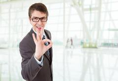 Business man with open arms winning, at the office Stock Photos