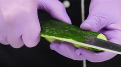 Chef carves crafts cucumber. Close up Stock Footage