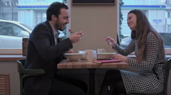 Business couple enjoy lunch meal at cafe Stock Footage