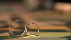 wedding ring roll and fall on each other - stock footage