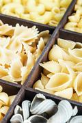 pasta assortment background. Pasta in a wooden box - stock photo