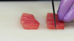 Chef lays out thin slices of fish. Close up Stock Footage