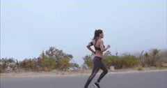 Fitness woman running on country road in foggy morning - stock footage