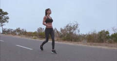 Fitness woman walking on country road. - stock footage