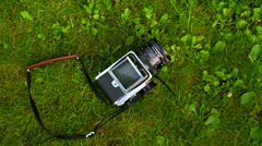 The Hasselblad camera lying on the grass Stock Footage
