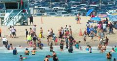 People swim in the Pacific Ocean in Santa Monica Beach, Los Angeles,4K RAW Stock Footage