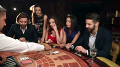 Company of Men and Women Playing Blackjack - stock footage