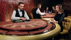 Dealer Shuffles the Young Woman in Casino Stock Footage
