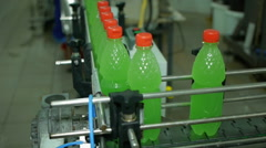 Lemonade soda bottles move along the conveyor belt are filled with packed twist Stock Footage
